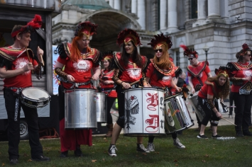 Drumming women.